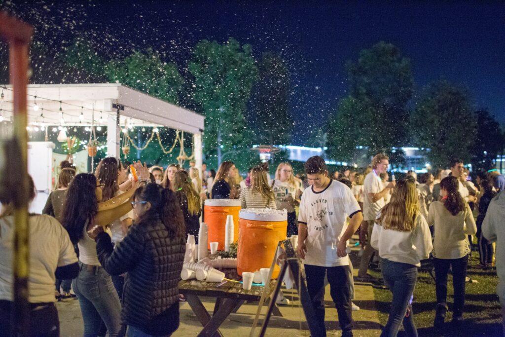 people dancing in an outdoor establishment