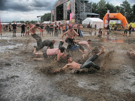 Festival Essentials men in mud